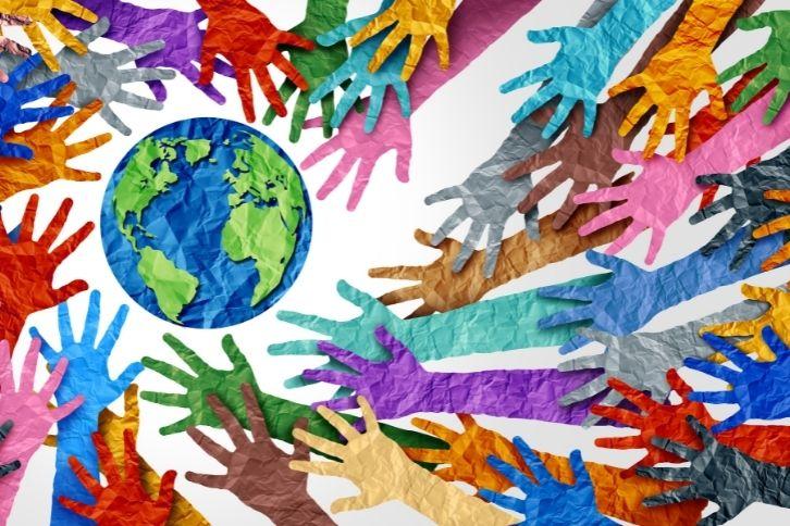 Hands around a paper globe