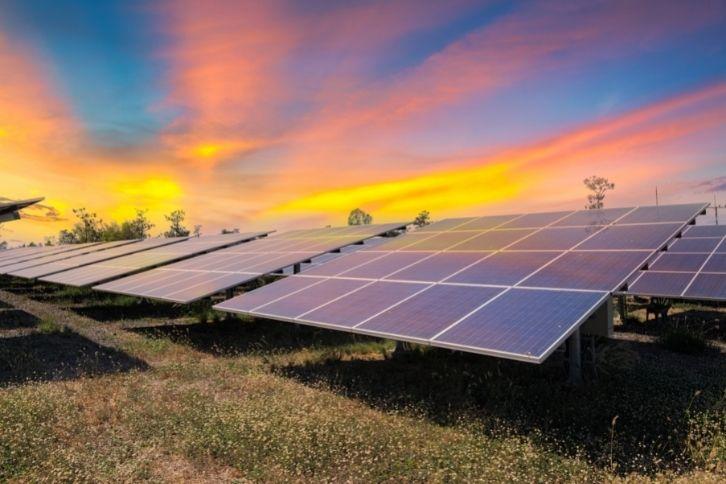 Solar panels under a setting sun